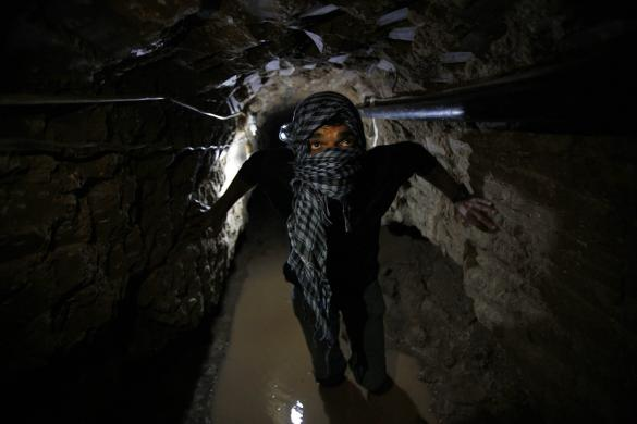 File photo shows Palestinian working inside smuggling tunnel flooded by Egyptian forces beneath Egyptian-Gaza border in Rafah