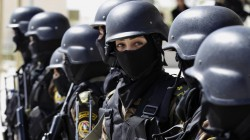 Female members of the Palestinian presidential guard take part in a training session in the West Bank city of Jericho