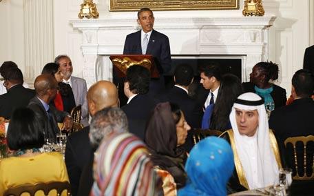 U.S. President Barack Obama speaks while hosting an Iftar dinner at the White House in Washington