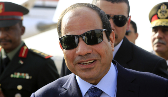 Egypt's President Sisi smiles upon arrival at Khartoum International Airport