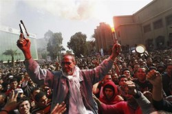 The father of an Al Ahly fan who was killed in Port Said celebrates with soccer fans in front of Al Ahly club after hearing the final verdict of the 2012 Port Said massacre in Cairo
