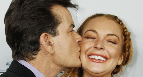 """Cast member Sheen kisses co-star Lohan on the cheek at the premiere of """"Scary Movie 5"""" in Hollywood"""
