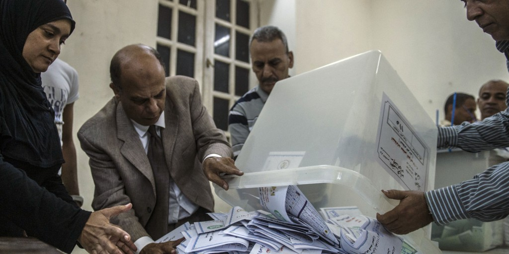 Election officials count ballots at the end of the first round of voting for Egypt's parliamentary election in Giza, Cairo on October 19, 2015. The first day of a parliamentary election in Egypt saw 15-16 percent of voters in the country turn out to cast ballots, Prime Minister Sharif Ismail said on October 19. AFP PHOTO / KHALED DESOUKI        (Photo credit should read KHALED DESOUKI/AFP/Getty Images)