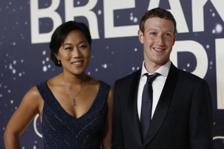 مارك زوكربيرج الرئيس التنفيذي لشركة فيسبوك وزوجته برسيلا تشان في كاليفورنيا يوم 9 نوفمبر تشرين الثاني 2014. تصوير: ستيفان لام - رويترز