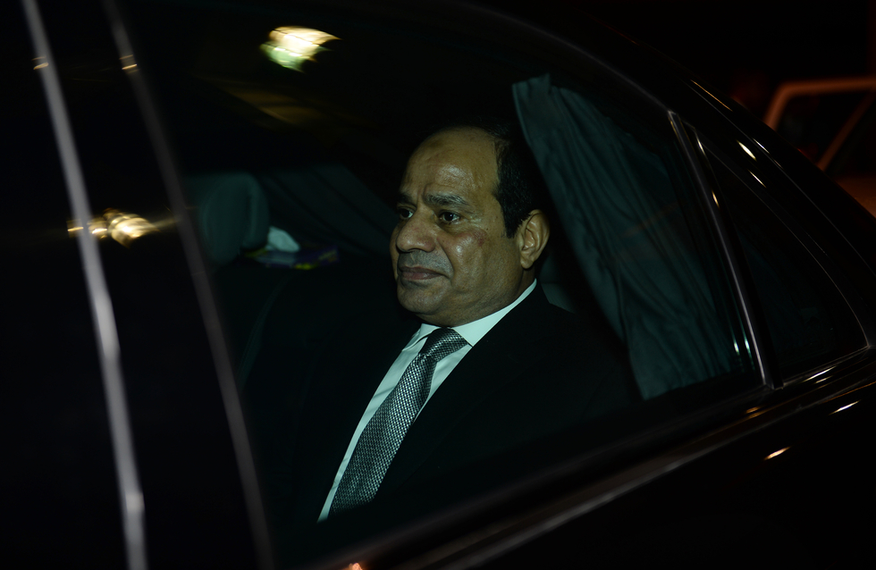 Egypt President Abdel Fattah al-Sisi leaves in a car following his arrival at Indira Gandhi International Airport for the Third India-Africa Forum Summit in New Delhi on October 28, 2015. India is hosting an unprecedented gathering of Africa's leaders as it ramps up the race for resources on the continent, where its rival China already has a major head start. AFP PHOTO / SAJJAD HUSSAIN