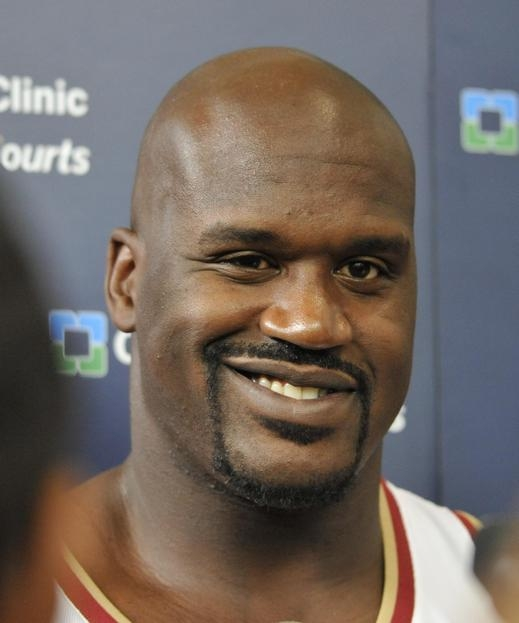Cleveland Cavaliers Shaquille O'Neal jokes with reporters during media day on Monday at the Cleveland Clinic Courts in Independence. MORNING JOURNAL/NATE PARSONS