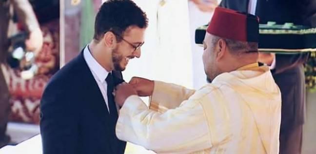 ملك المغرب يقلد لمجرد وساما ر