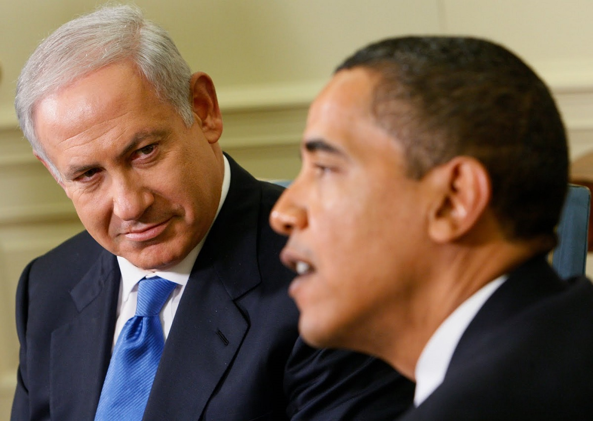 Israeli Prime Minister Benjamin Netanyahu looks towards President Barack Obama as he speaks to reporters in the Oval Office of the White House in Washington, Monday, May 18, 2009. (AP Photo/Charles Dharapak)