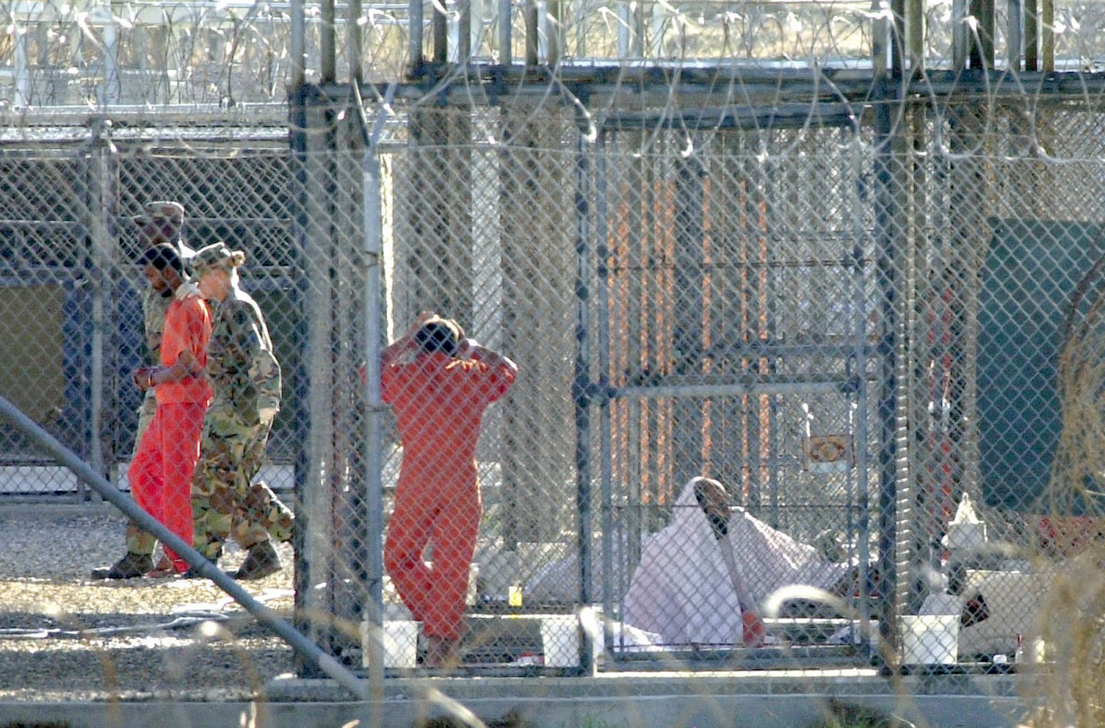 Inmates, Guards at Camp X-Ray. Guantanamo Bay, Cuba. Owned and Provided by Miami Herald. Photographer Unknown.