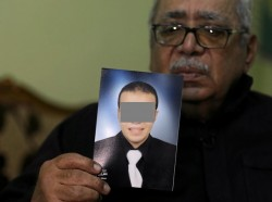 Reda Abdullah al-Hamamy, the father of Abdullah Reda al-Hamamy who is suspected of attacking a soldier in Paris' Louvre museum, holds a picture of his son during an interview with Reuters in Daqahliya, Egypt, February 4, 2017. REUTERS/Mohamed Abd El Ghany     FOR EDITORIAL USE ONLY. NO RESALES. NO ARCHIVES